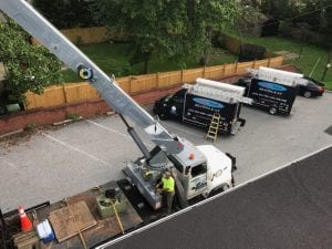 Rooftop HVAC installation with Crane