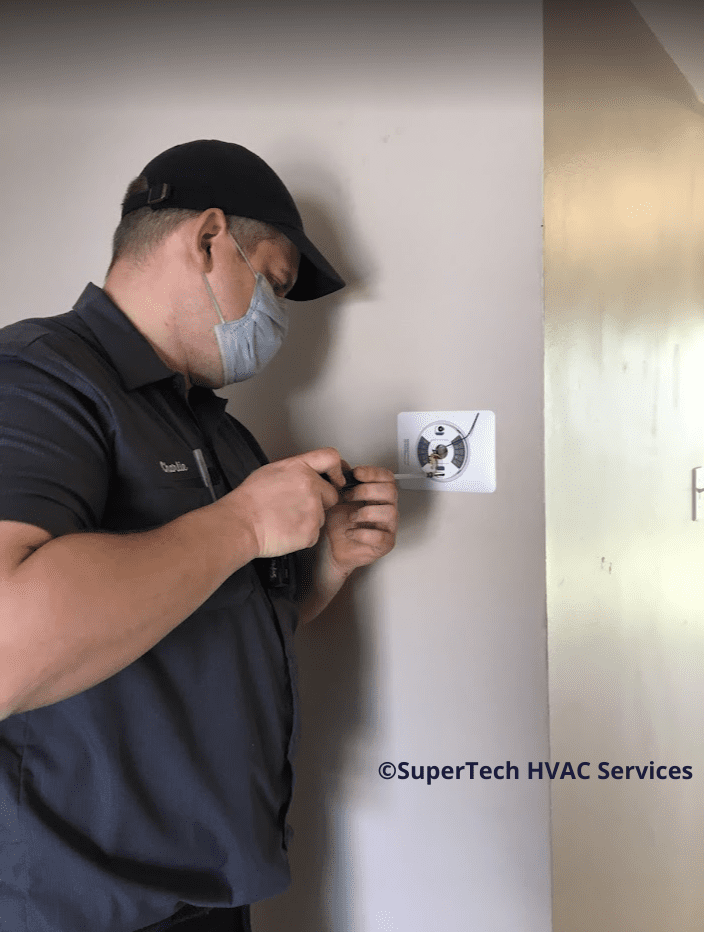 Charlie fixing thermostat