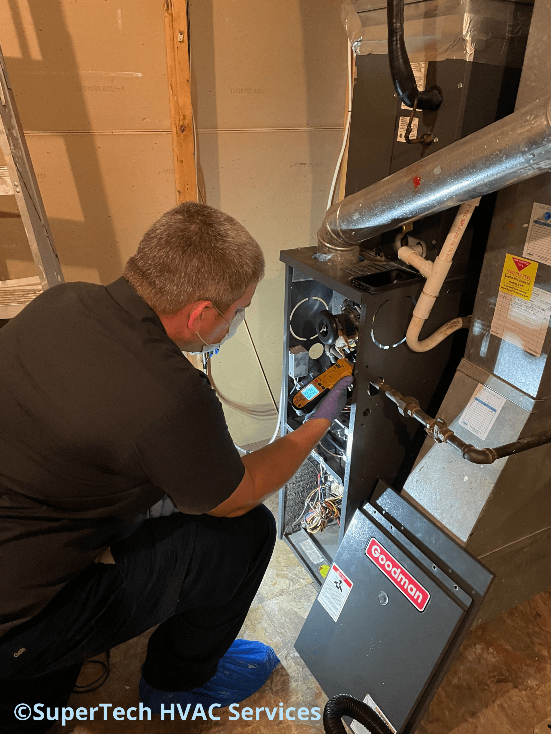 Charlie is checking the amp for the inducer motor during a Furnace Tune Up.