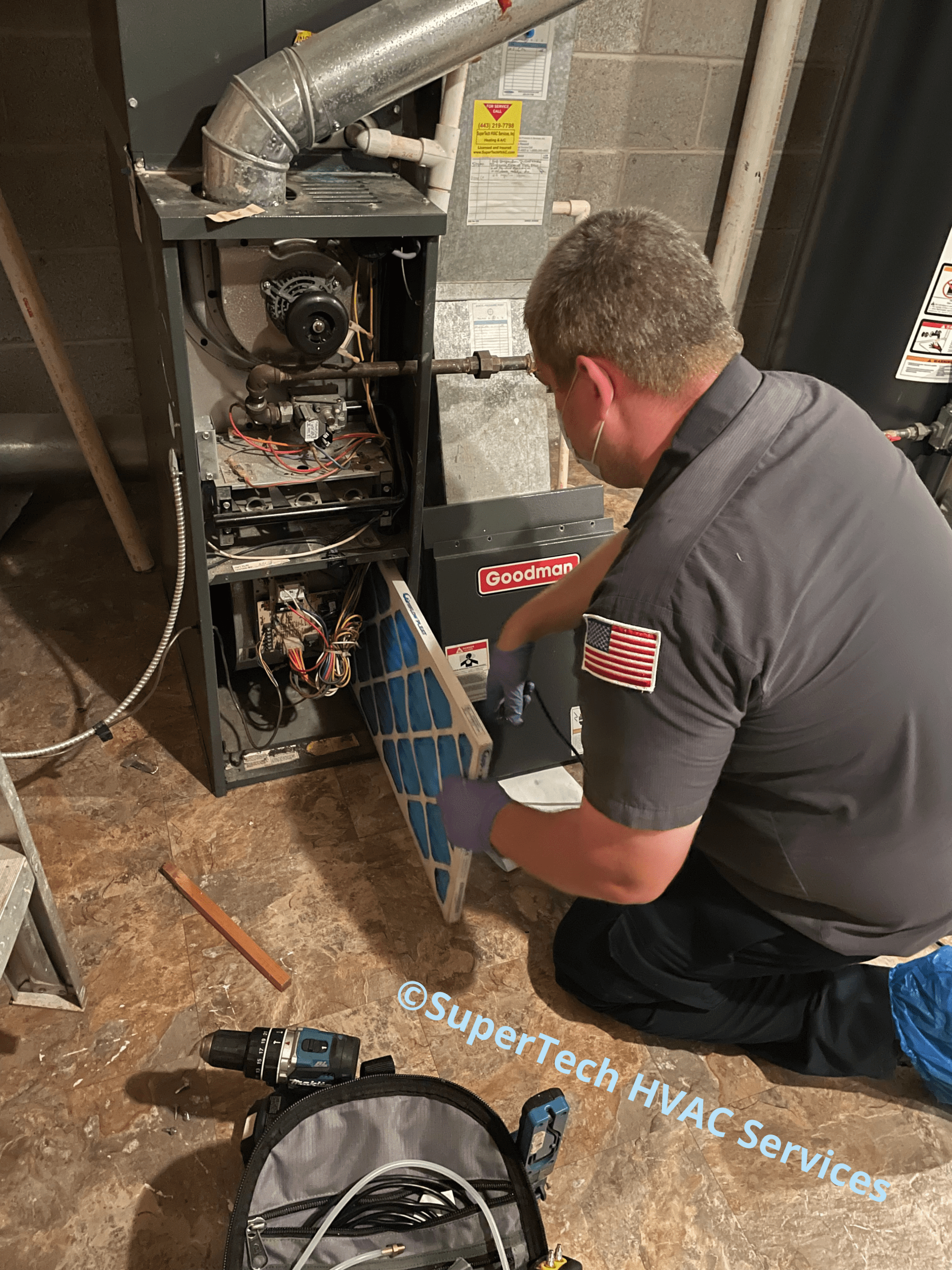 Charlie changing filter during furnace tune up