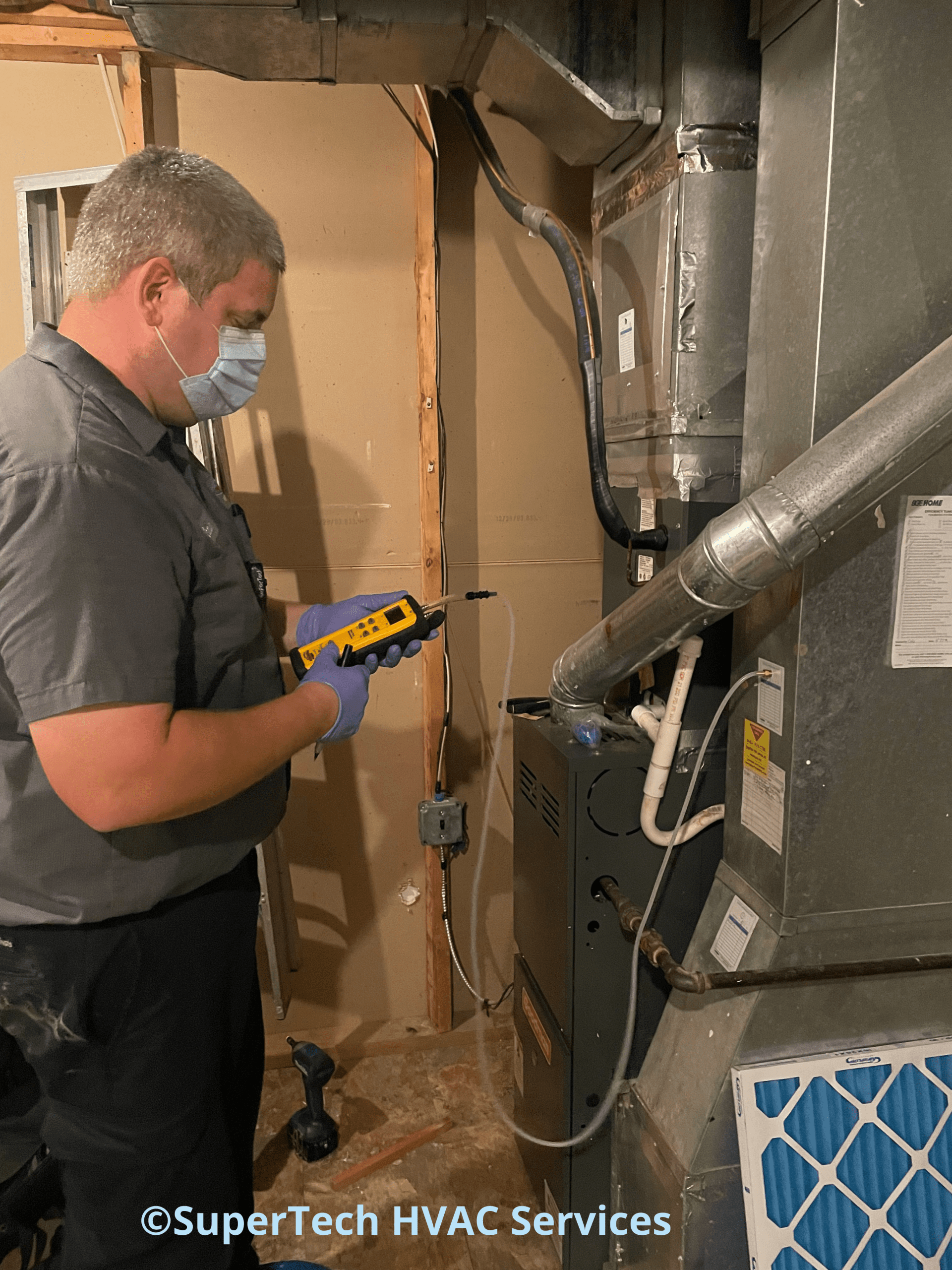 checking static pressureduring a furnace tune up.